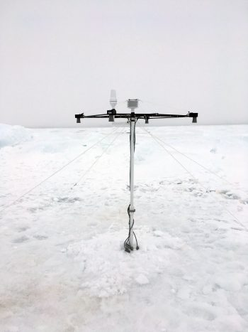 Figure 6b. This photograph shows the MetOcean Snow Buoy set up on Arctic sea ice in the Chukchi Sea.