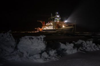 Figure 4. The Polarstern, frozen into the sea ice in the dark Arctic night during the MOSAiC expedition. ||Photo credit: Alfred-Wegener-Institut/Esther Horvath (CC-BY 4), from http://ciresblogs.colorado.edu/mosaic/2019/12/03/creating-a-mountain/.| High-resolution image