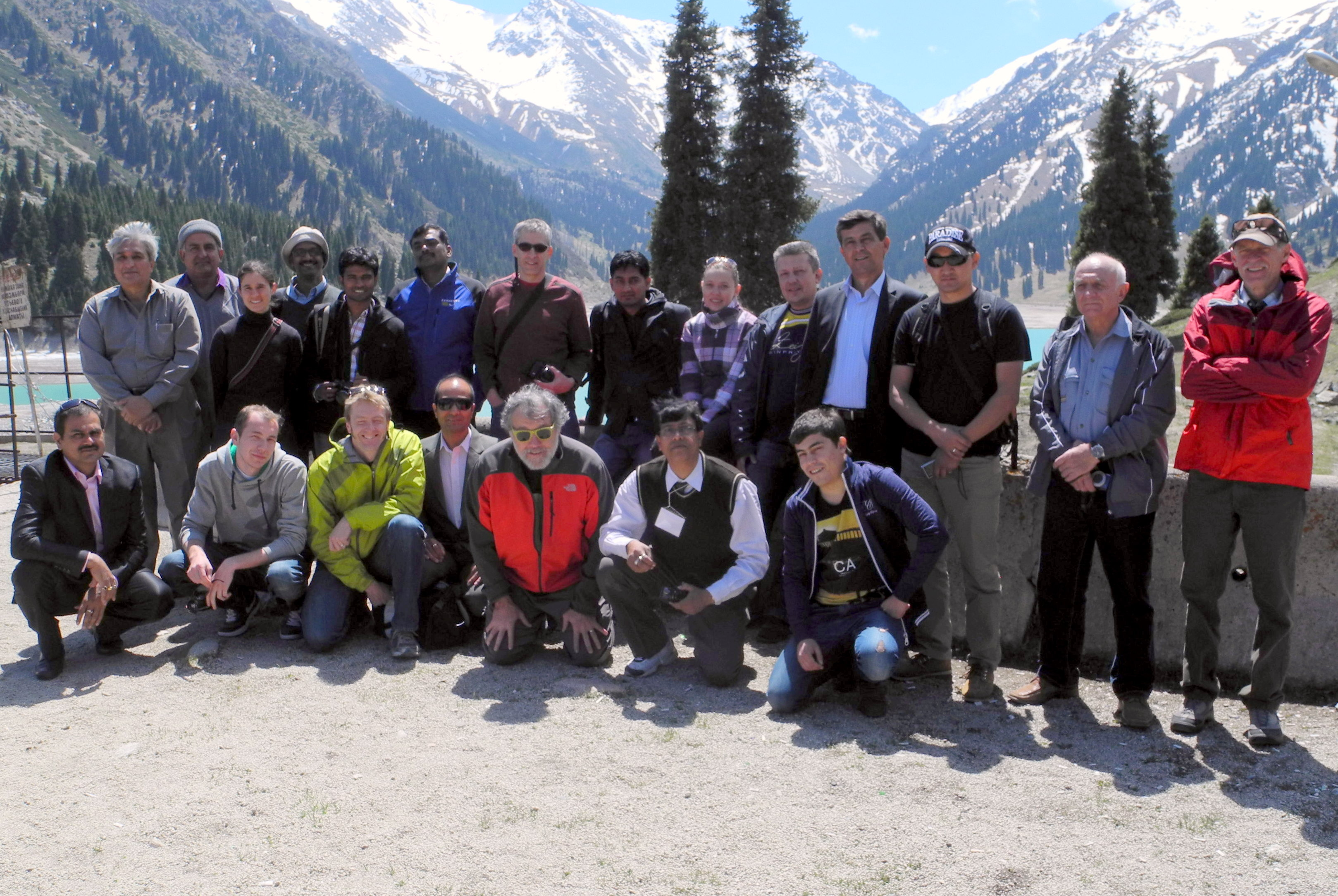 The CHARIS group near the Big Almaty Lake field station. Back row, standing, from left to right are Danial Hashmi, Rafaqat Ali Malik, Alana Wilson, George Jose Pottakkal , Shaktiman Singh, A.L. Ramanathan, Bruce Raup, Bikas Chandra Bhattarai, Larissa Kogutenko, Alexandr Yegorov, Inom Sherovich Normatov, Bakyt Ermenbaev, Vladimir Shatravin, and Richard Armstrong. Front row, kneeling, from left to right are Rajesh Kumar, Danila Uvarov, Andy Barrett, Rijan Bhakta Kayastha, Mark Williams, Chandranath Chatterjee, and Parviz Normatov.