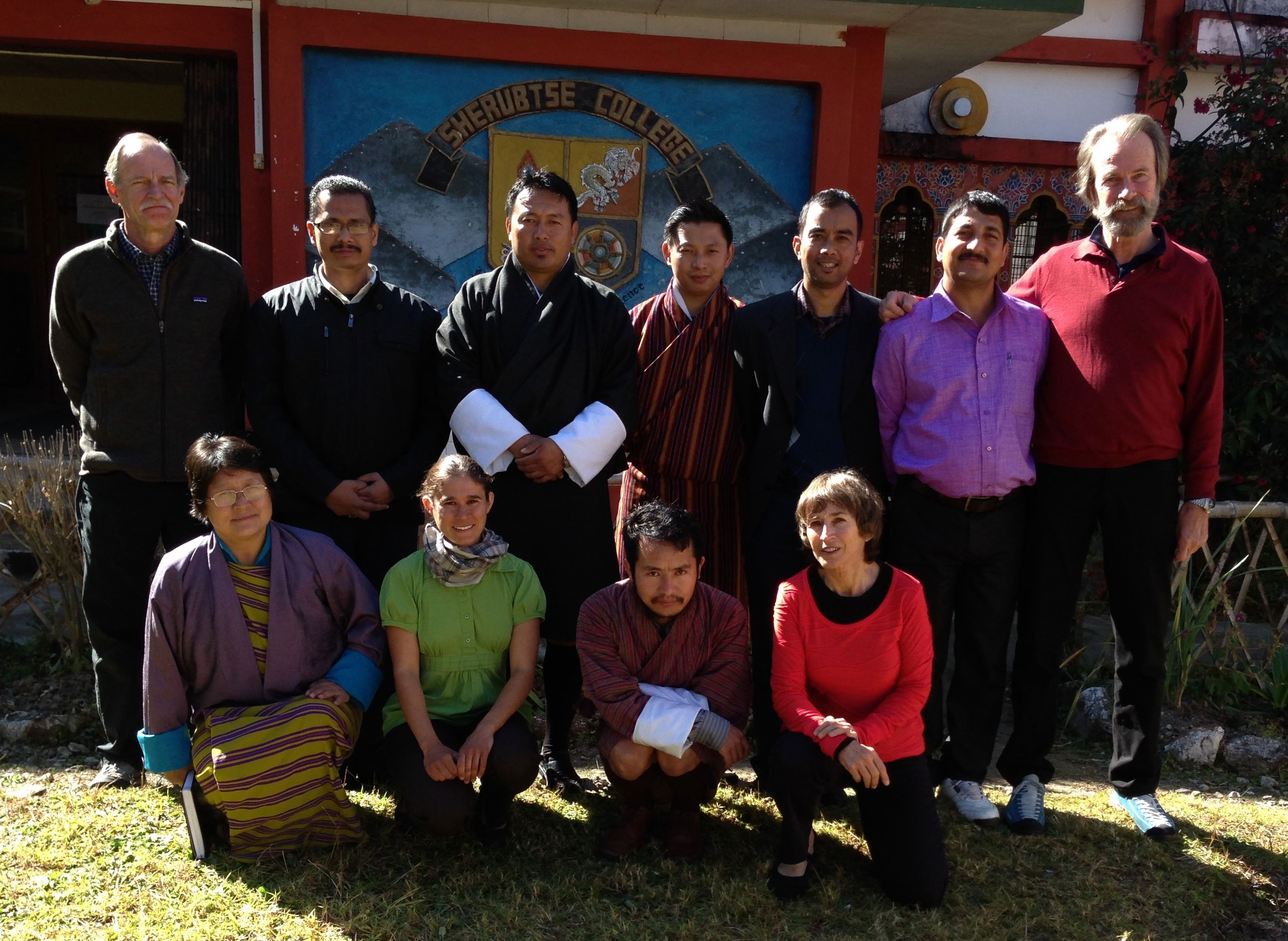 CHARIS team with members of the Center for Climate Change and Spatial Information (CCCSI), Sherubtse College, Royal University of Bhutan, November 23, 2013. Kneeling, left to right: Dr. Sonam Wangmo, Dean of Academic Affairs; Alana Wallace; Pema Lhendrup, Lecturer, Department of Geography; Betsy Armstrong Standing, from left to right: Richard Armstrong; Ramakanta Barman, Assistant Professor, Department of Chemistry; Tshering Wangdi, Director; Sonam Chogyel, Dean of Research and Industrial Linkages; Pankaj Thapa, Assistant Professor, Department of Geography and Coordinator, CCCSI; Dharmendra Chaudhur, Senior Lecturer, Geography and Planning; Koni Steffen, WSL