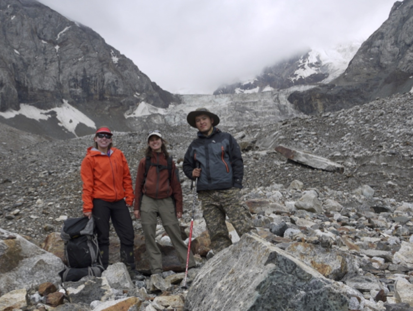 Alice Hill, Alana Wilson, and Muhammed Esenamanov (L to R) finish water sample collection at the Kara Batkak Glacier, Tien Shan Mountains, Kyrgyzstan