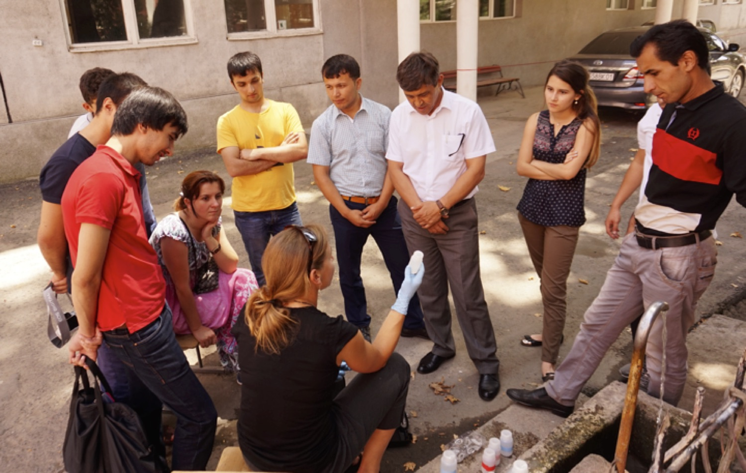 Alice Hill demonstrates field water sampling protocols with Inom Normatov's research group at Tajik National University in Dushanbe, Tajikistan.