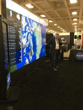 Steve Tanner demonstrates functions of the Operation IceBridge Portal at the NASA Booth during the 2015 AGU Fall Meeting.