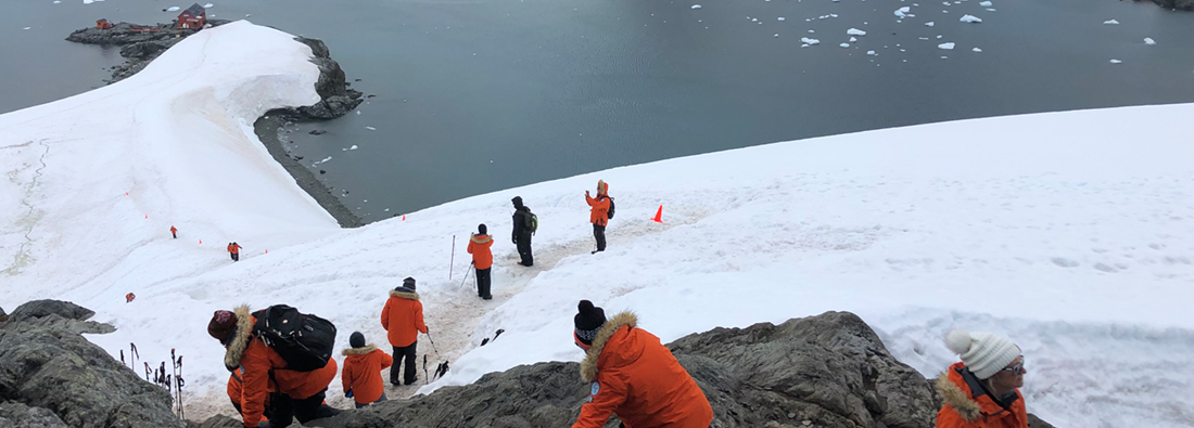 Researchers on Antarctic hill