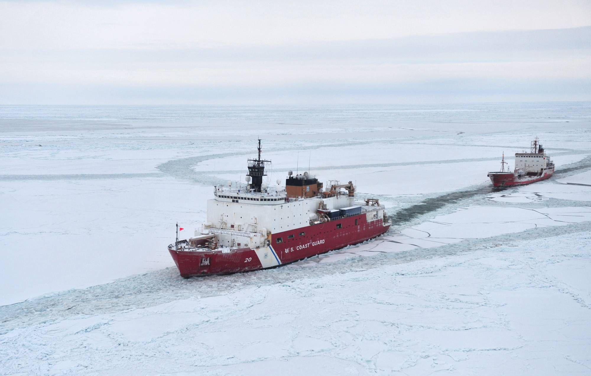 Photograph of U.S. Coast Guard Cutter Healy escorting the Russian tanker Renda through the Arctic ice