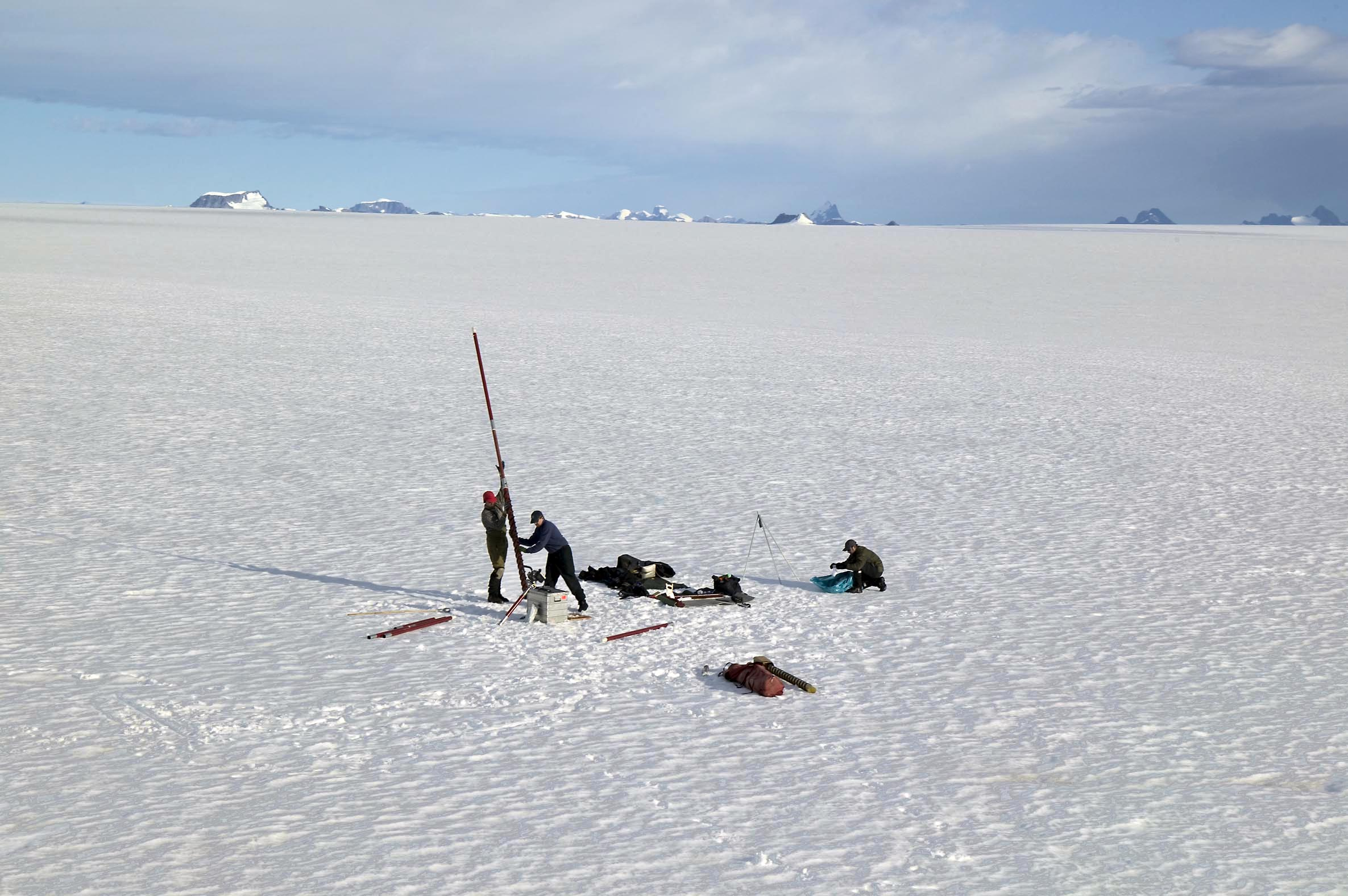 Scientist Jason Box drills a long hole to extract ice core samples. These enable him to map precipitation and melt levels for the South Eastern tip of Greenland. Credit: Nick Cobbing/Greenpeace.