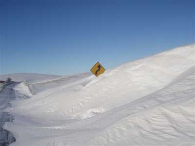 Large snow drifts on Washington State Route 27