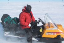 Ted Scambos on snowmobile