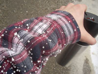 Photograph of graupel on a shirtsleeve