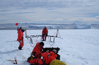 researchers on the tempanito iceberg near antarctica
