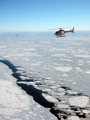 An aerial view of the helicopter taking data of the sea ice below