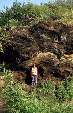 man in front of peat layer