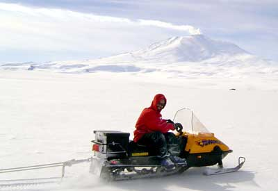 Scientist on a snowmobile in Antarctica