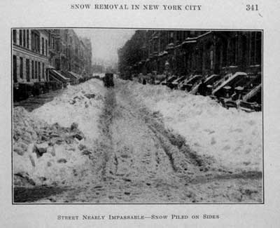 Piles of snow border a New York City street