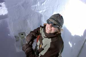 Researcher taking snow samples in Antarctica