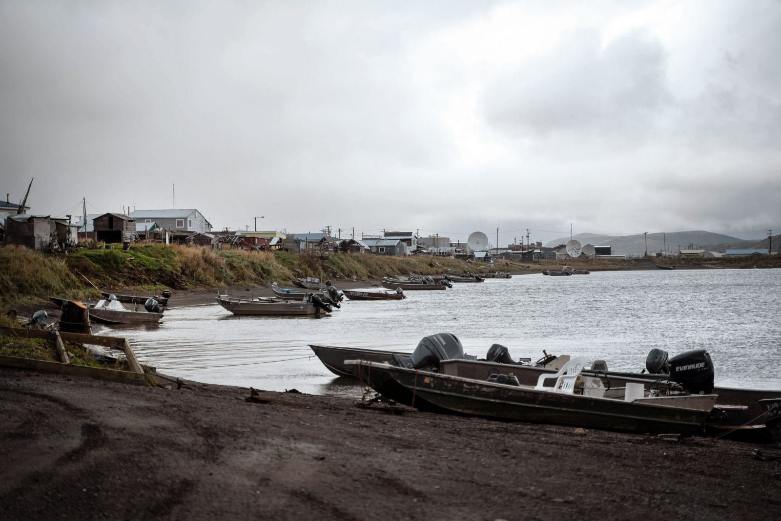 Fishing boats line the shore in Unalakleet, Alaska.