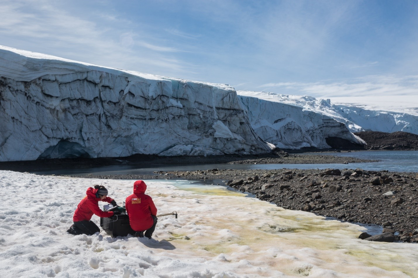 Dr. Alia Khan and colleague Edgardo Sepulveda collect spectra albedo measurements in front of Collins Glacier on King George Island. Credit: Gonzalo Barrera