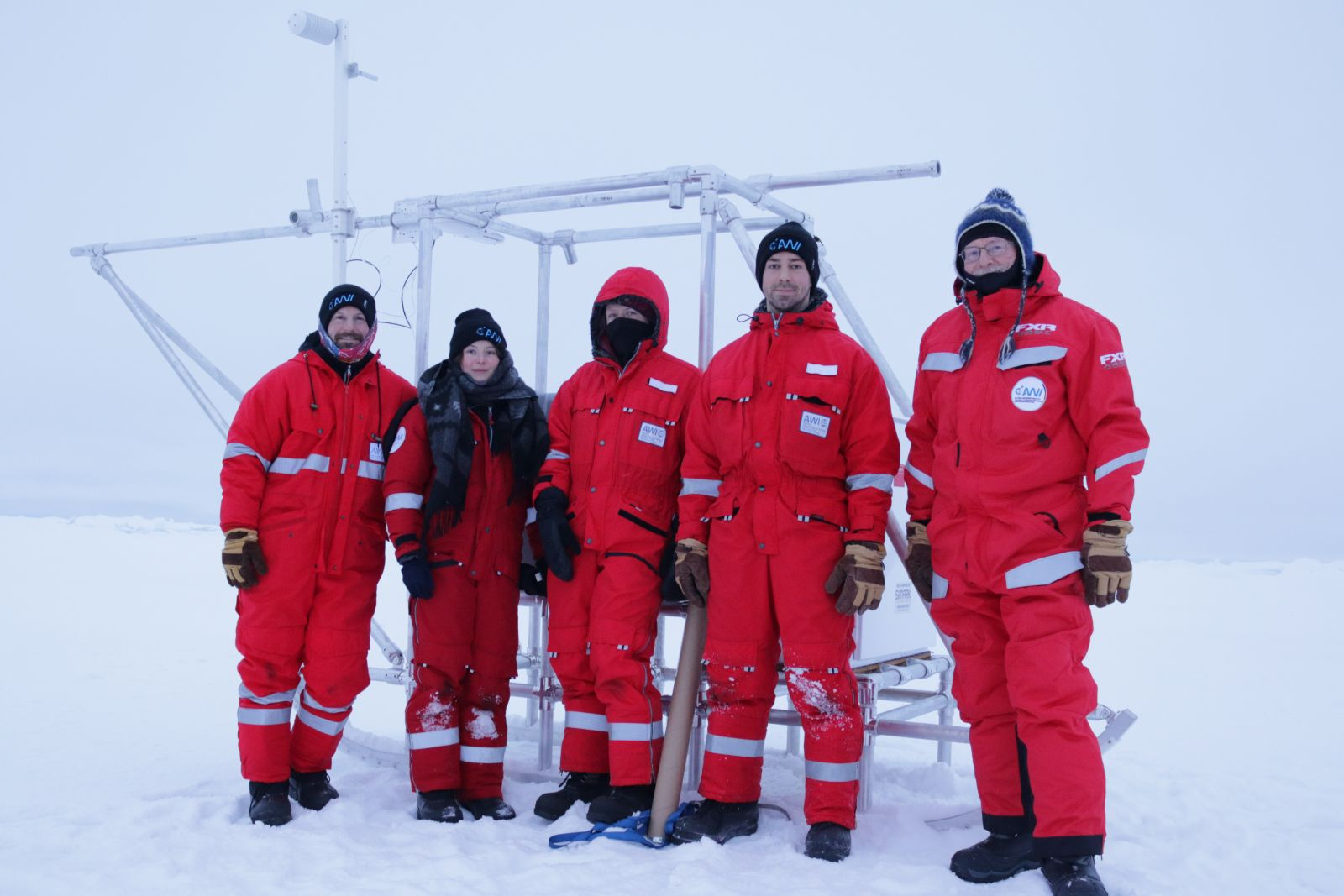 Scientists and students pause for a quick photo while setting up the meteorological station on the sea ice. From left to right: Sean Horvath, Julika Zinke, Anne Gold, Neil Aellen, and Ola Persson.