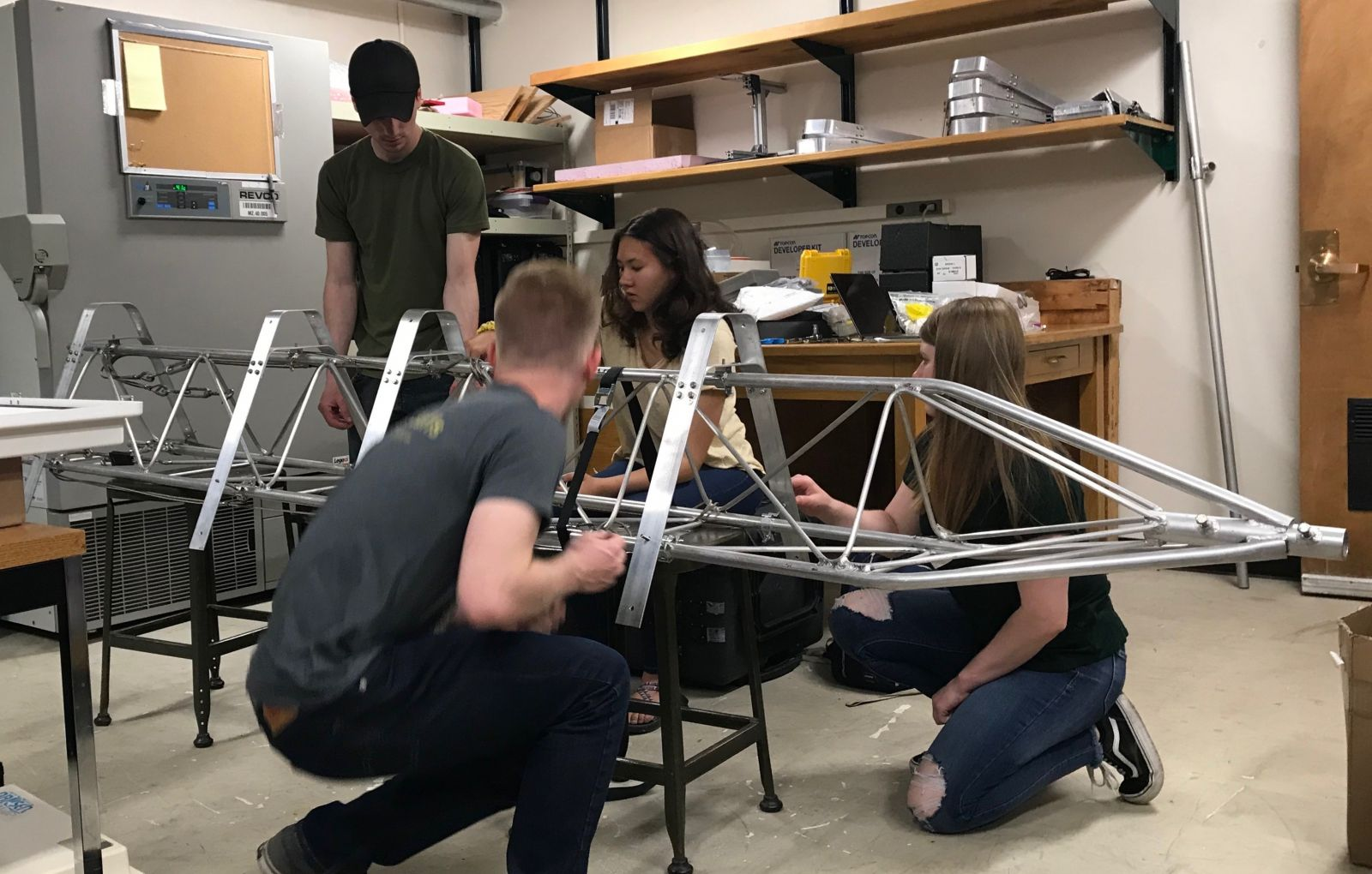 Team JANE assembling the AMIGOS tower with mounts to test for the solar panel attachment. From left to right: Jack Soltys, Ryan Weatherbee Skylar Edwards, and Emma Tomlinson.