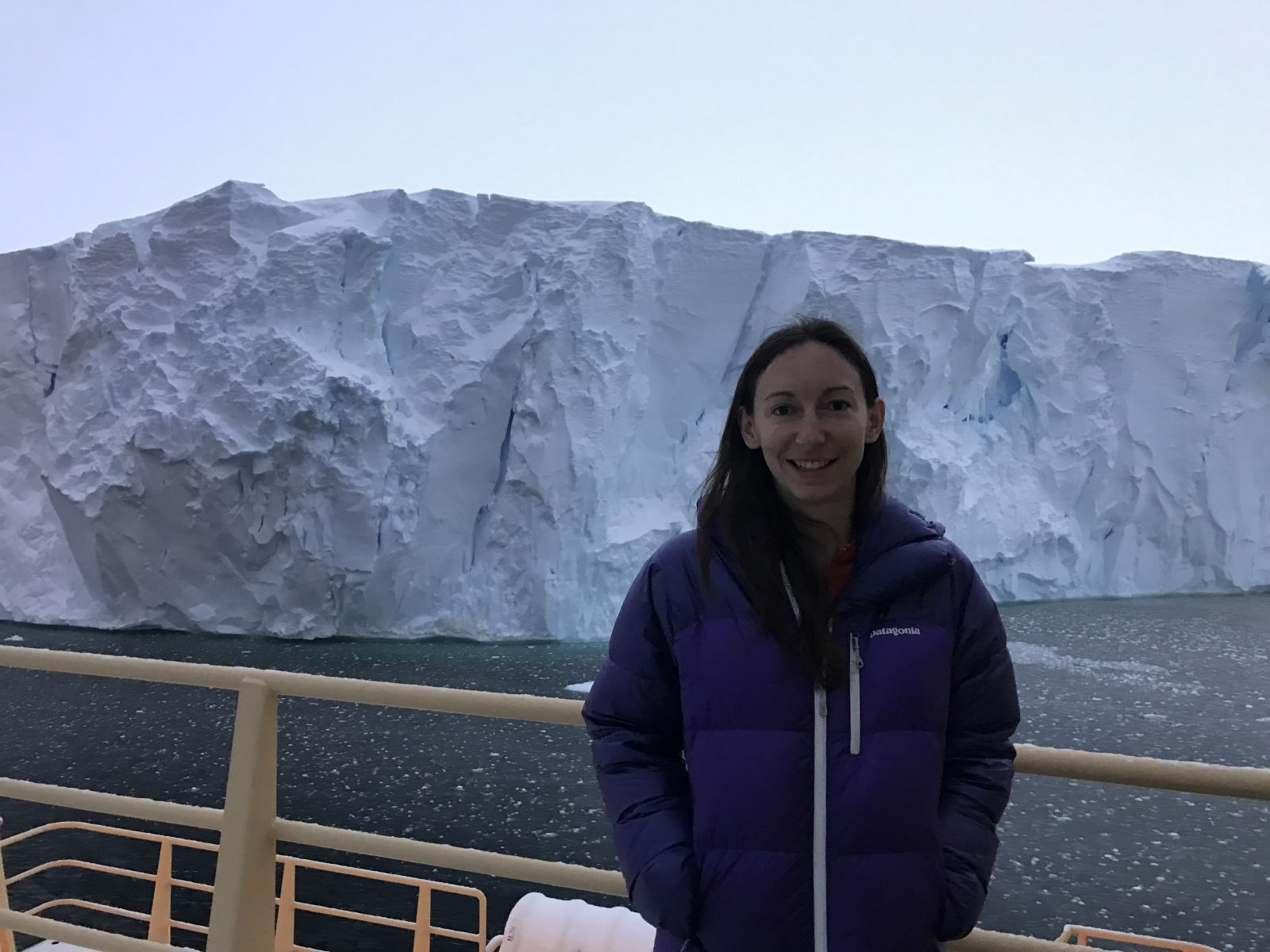 Tasha Snow stands in front of the Thwaites ice shelf.