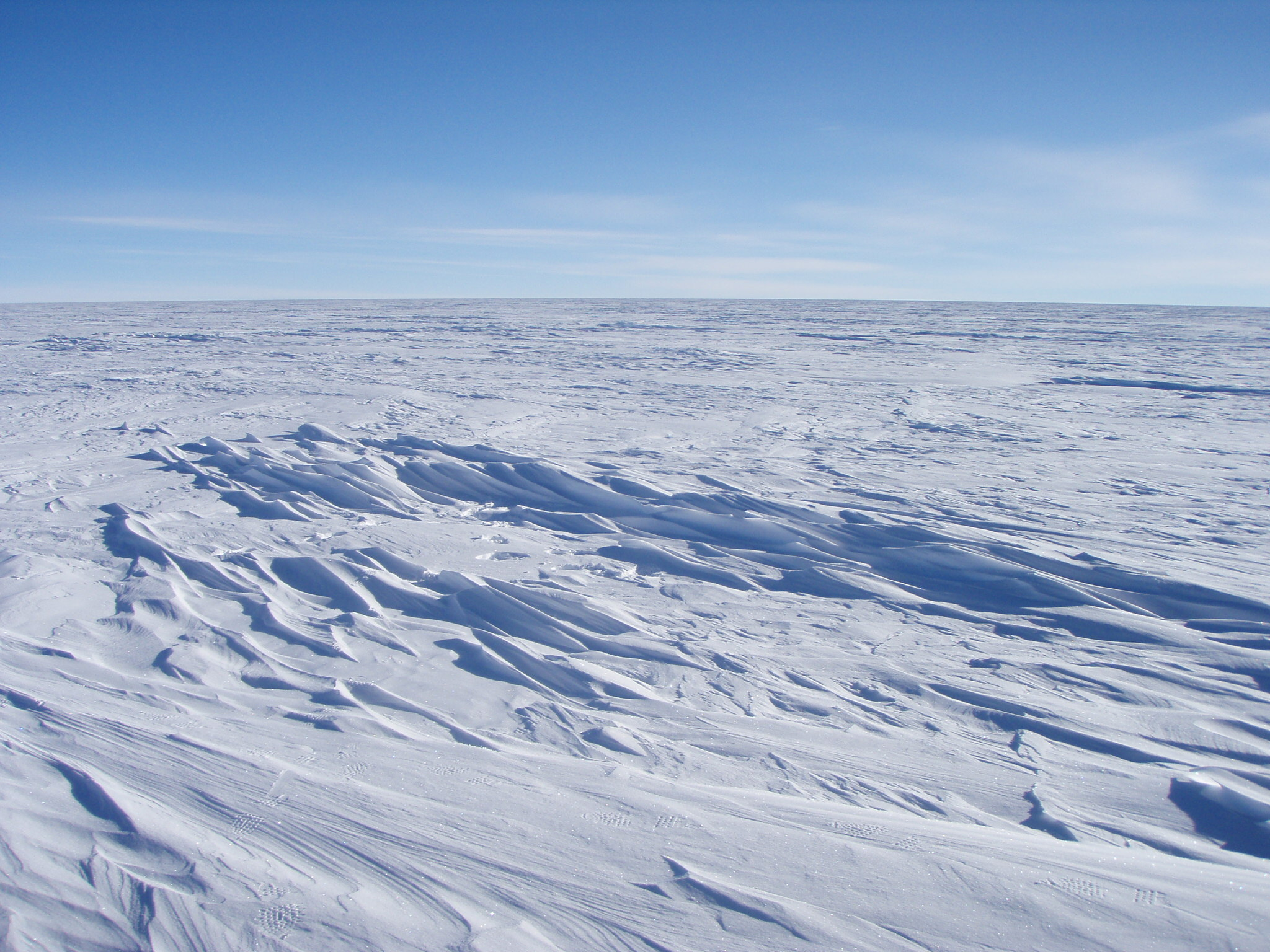 Sastrugi snow formations on the surface of the snow in East Antarctica
