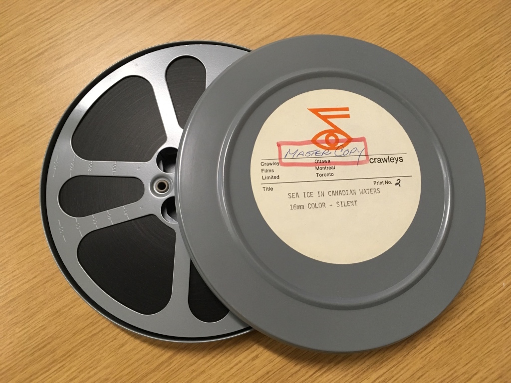 Photograph of analog sea ice data on reel-to-reel tapes