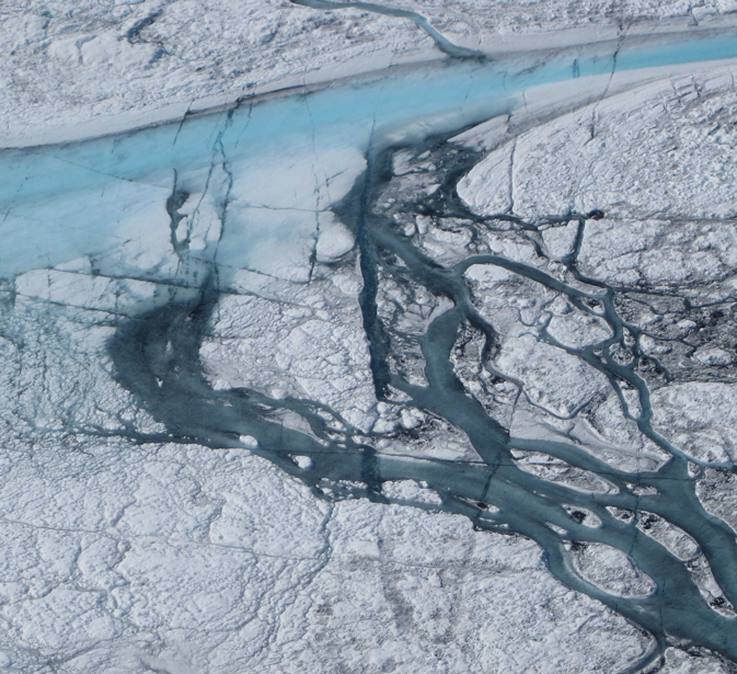 Photograph of meltwater streams on the Greenland Ice Sheet during the summer of 2012