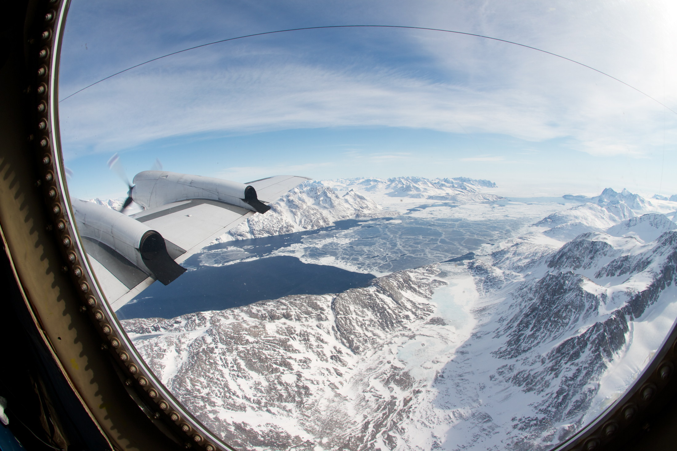 Icy water in the fjord of the Kangerdlugssuaq Glacier in eastern Greenland, as seen from NASA's P-3B aircraft during an Operation IceBridge flight. Diverse data on the Arctic, including IceBridge data, can be discovered through the Arctic Data Explorer. Image Credit: NASA/Jefferson Beck.