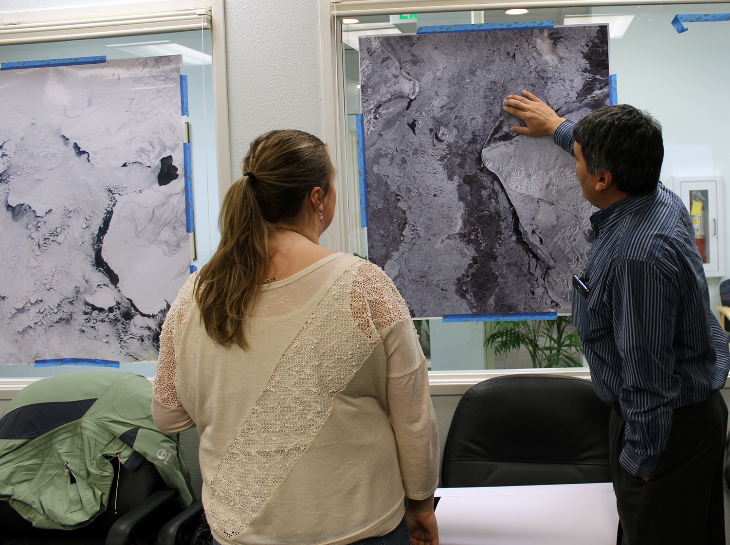 Lewis Brower, Sea Ice expert from Barrow, Alaska, shares his knowledge with Rebecca Legatt from the National Weather Service's Anchorage Ice Desk. Combining knowledge, expertise, and data can greatly enhance the understanding of sea ice. Credit: P. Pulsifer