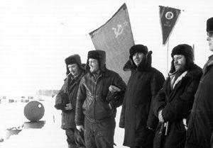 "Flag ceremonies at North Pole stations typically marked the establishment of each new team. Image credit: EWG. (<a href=""/cryosphere/gallery/photo/34060"">View photo detail.</a>) <br>"