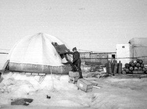 "Tents at NP-1 served as both living and working areas. On subsequent stations, however, such as that pictured here, tents were used mainly for supply storage. Plywood was used for buildings that housed people and laboratories. Image credit: EWG. (<a href=""/cryosphere/gallery/photo/34066"">View photo detail.</a>) <br>"