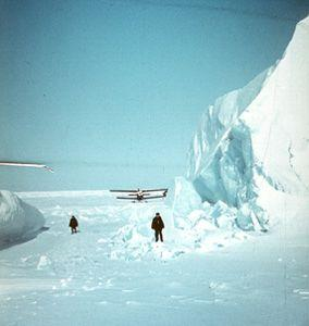 "A biplane landing near an iceberg, off the Laptev Sea. Image credit: EWG. (<a href=""/cryosphere/gallery/photo/34067"">View photo detail.</a>) <br>"