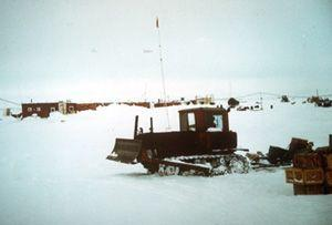 "Harsh and extreme arctic conditions required special considerations when trying to build any type of structure. Heavy machinery was used to construct and maintain the runways that allowed planes to deliver supplies. When not used for runways, tractors such as this one would be used for other construction around the camp. Image credit: EWG. (<a href=""/cryosphere/gallery/photo/34073"">View photo detail.</a>) <br>"
