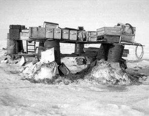 "Even if materials didn't need to be housed within a building, storing them outside also posed difficulties. Supplies were stacked on fuel barrels to elevate them above the snow and to protect them from melt water during summer. Image credit: EWG. (<a href=""/cryosphere/gallery/photo/34076"">View photo detail.</a>) <br>"