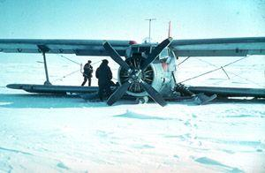 "Most of the time, the only way to deliver supplies to the North Pole stations was by plane. Weather conditions in the sky could be just as harsh and extreme as conditions on the ground. Here, a biplane is grounded after an accident near the Kara Sea in 1981. Image credit: EWG. (<a href=""/cryosphere/gallery/photo/34079"">View photo detail.</a>) <br>"