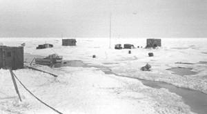 "During summer, moving around camp became difficult, as melting snow formed large puddles (melt ponds) and channels everywhere. Image credit: EWG. (<a href=""/cryosphere/gallery/photo/34083"">View photo detail.</a>) <br>"