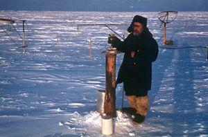 "German Maximov collecting the measurement of direct solar radiation. Image credit: EWG. (<a href=""/cryosphere/gallery/photo/34088"">View photo detail.</a>) <br>"