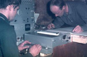 "Not all measurements required venturing outside. Aerologists Makurin and Ippolitov recording radio-sounding data at NP-16 in 1968. Image credit: EWG. (<a href=""/cryosphere/gallery/photo/34089"">View photo detail.</a>) <br>"