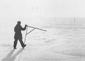 "A lone station member taking snow line (snow survey) measurements. Image credit: EWG. (<a href=""/cryosphere/gallery/photo/34090"">View photo detail.</a>) <br>"