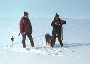 "Two station members traverse the snow survey line measuring snow density by weight. Image credit: EWG. (<a href=""/cryosphere/gallery/photo/34092"">View photo detail.</a>) <br>"