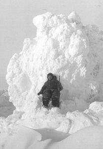 "This station member was just climbing around on the ridges and hummocks of the ice floe, but, like all who ventured away from camp, he carried a rifle for protection from polar bears. Image credit: EWG. (<a href=""/cryosphere/gallery/photo/34099"">View photo detail.</a>) <br>"