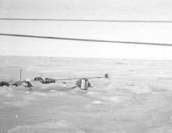 "When the anchors were not insulated, the snow melted out from around the mast bases, causing them to topple. Image credit: EWG. (<a href=""/cryosphere/gallery/photo/34104"">View photo detail.</a>) <br>"