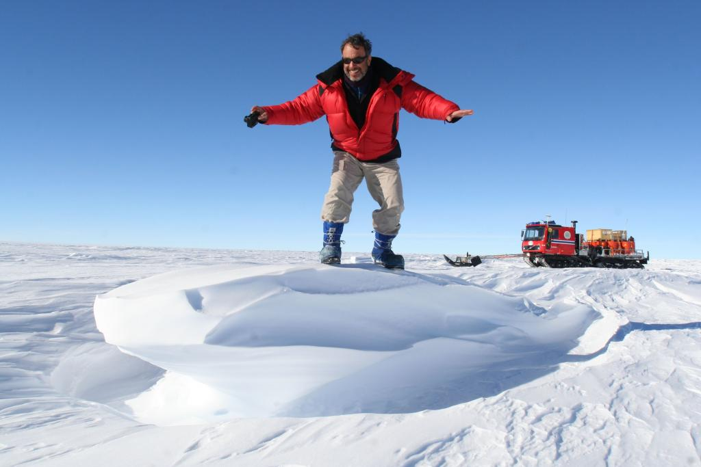 "Ted pretends to surf on a sastrugi, a snow formation caused by strong winds. Image Credit:  Ted Scambos, NSIDC (<a href=""/cryosphere/gallery/photo/33728"">View photo detail.</a>) <br>"