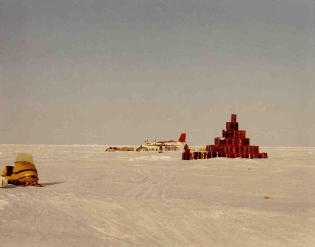 "Twin otter loading during evacuation of AIDJEX camp. Oil drums left as radar target; 1971 AIDJEX pilot study. Image Credit:  National Snow &amp; Ice Data Center <a href=""http://nsidc.org/data/aidjex/"">AIDJEX Web site</a> (<a href=""/cryosphere/gallery/photo/33444"">View photo detail.</a>) <br>"