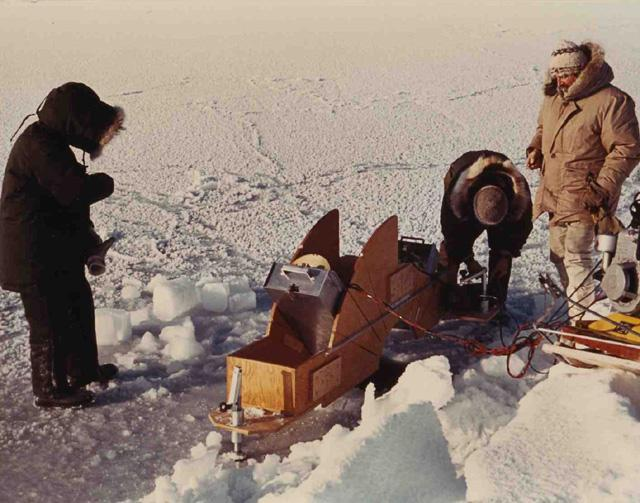"1971 AIDJEX pilot study: An emissometer was used by CRREL-USGS-AEROJET to measure microwave emissivity of sea ice (Far right W. Campbell) Image Credit:  National Snow &amp; Ice Data Center <a href=""http://nsidc.org/data/aidjex/"">AIDJEX Web site</a> (<a href=""/cryosphere/gallery/photo/33467"">View photo detail.</a>) <br>"