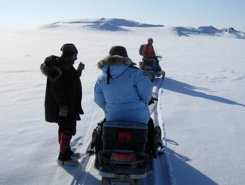 "Researchers discuss plans during the 2009 SnowNet project. From left to right: Matthew Sturm, Drew Slater, and Sveta Berezovskaya Image courtesy Mark Serreze, NSIDC. (<a href=""/cryosphere/gallery/photo/33623"">View photo detail.</a>) <br>"