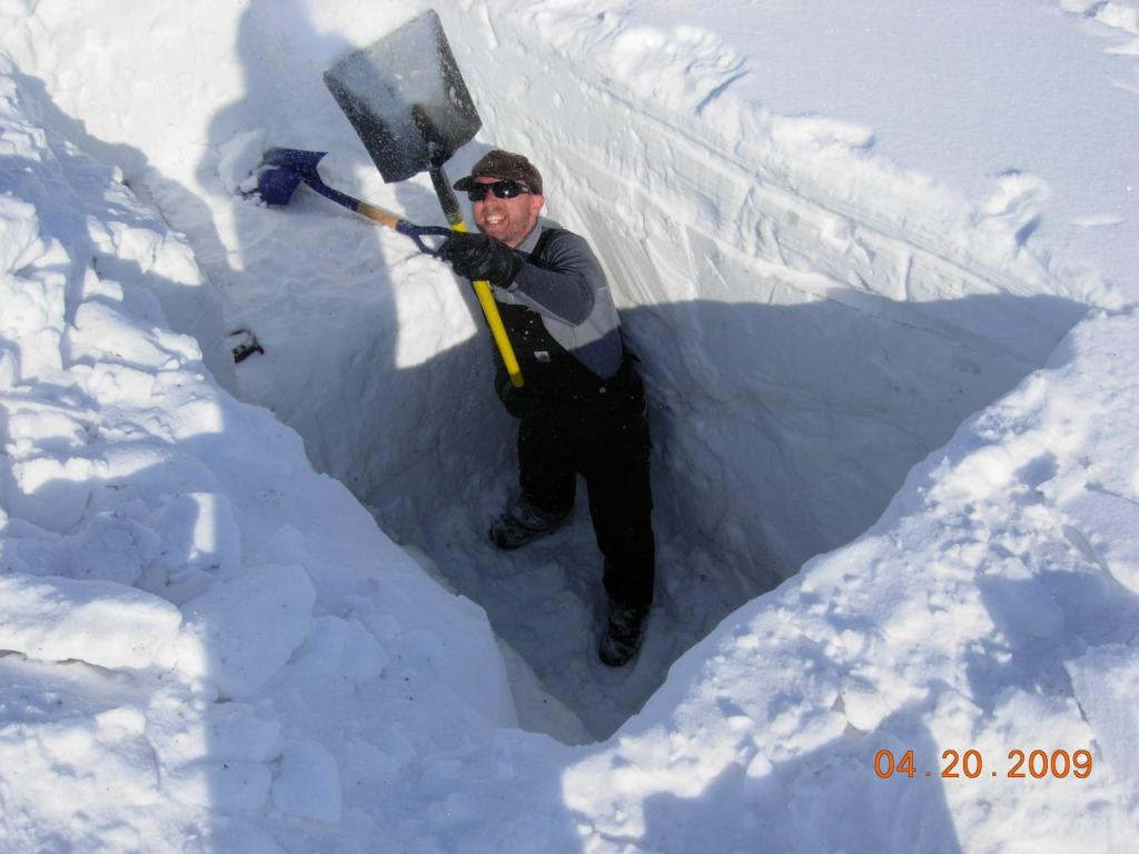 "Drew takes a turn in the pit. Image courtesy Mark Serreze, NSIDC. (<a href=""/cryosphere/gallery/photo/33626"">View photo detail.</a>) <br>"