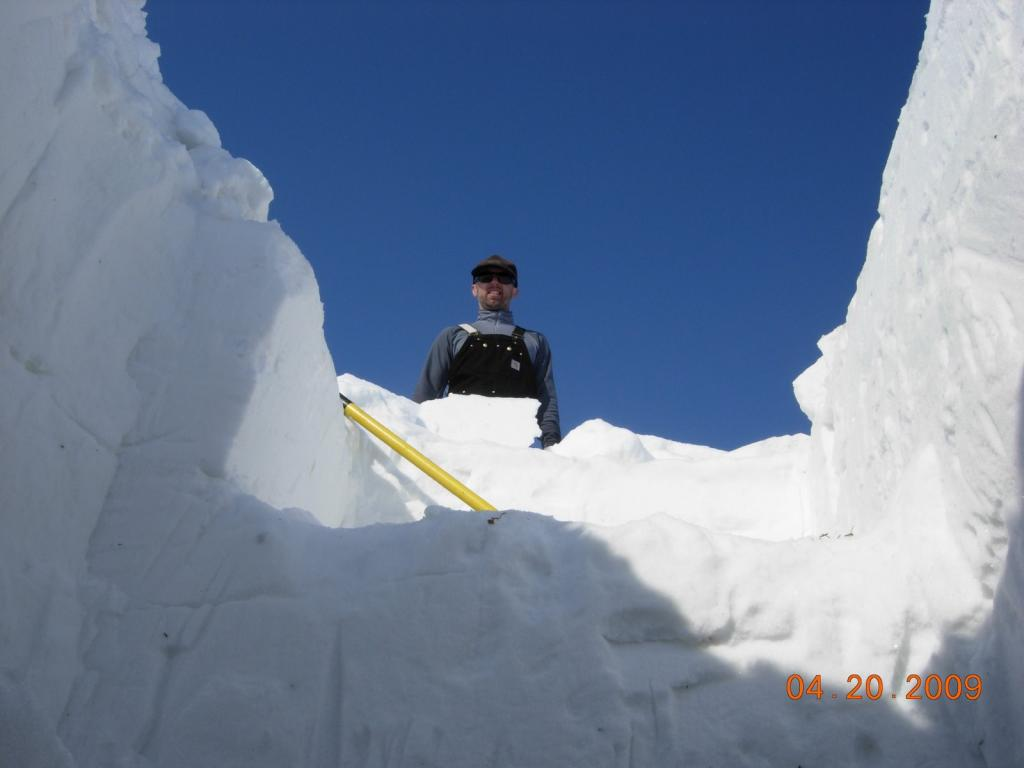 "The snow pit looks deep when you're standing at the bottom. Image courtesy Mark Serreze, NSIDC. (<a href=""/cryosphere/gallery/photo/33629"">View photo detail.</a>) <br>"