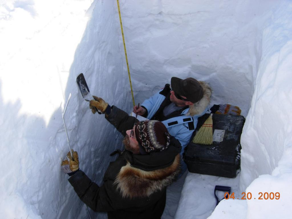 "Matthew & Drew work the monster snow pit. Image courtesy Mark Serreze, NSIDC. (<a href=""/cryosphere/gallery/photo/33628"">View photo detail.</a>) <br>"