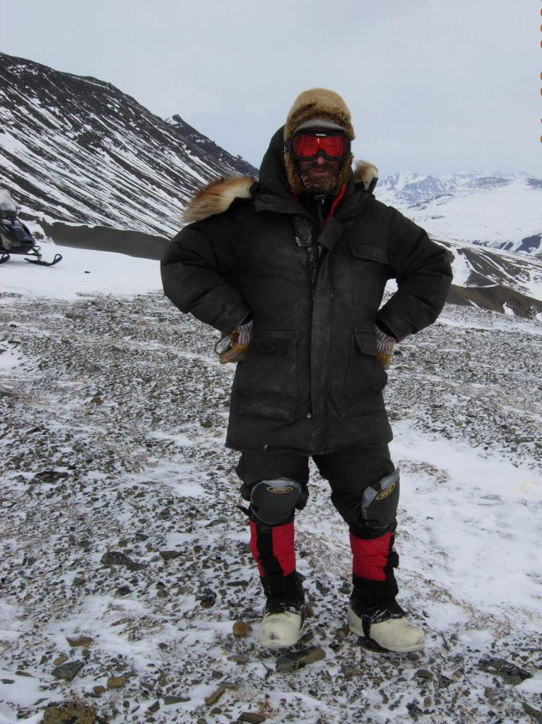 "Snow Guru Matthew Sturm poses atop Atigun Gorge. Image courtesy Mark Serreze, NSIDC. (<a href=""/cryosphere/gallery/photo/33632"">View photo detail.</a>) <br>"